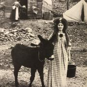 Lachlan McLean photograph of a pioneer woman with a burro in 19th century Clear Creek County