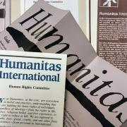 Paper documents from the Humanitas International organization, founded by Joan Baez