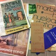 Materials from the Atomic West Collection, including government brochures on nuclear energy.