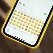 a phone displaying emojis
