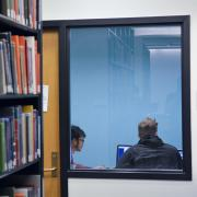 Students working the a study room in the Gemmill Library of Engineering, Math & Physics