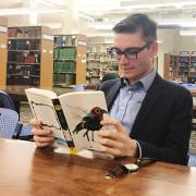 A student reading for pleasure in Norlin Library.