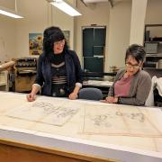 Interns Lisa Donavan and Stacey Brown work on maps from the U.S. Congressional Serial Set volumes in the Preservation unit.