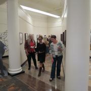 People attending Shakespeare's Bouquet exhibit