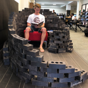 A student sitting in the second stacked brick compisition.