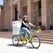 Megan Welsh on the library bike cart