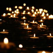Candles in a vigil. Photo by Mike Labrum on Unsplash