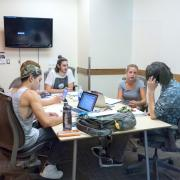 Students study in a group study room.