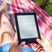 Woman reading ebook in hammock