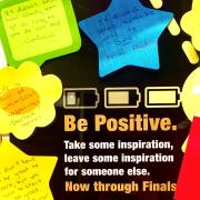 A banner with inspirational messages written on post-it notes.