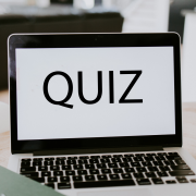 A laptop with the word quiz on the screen.