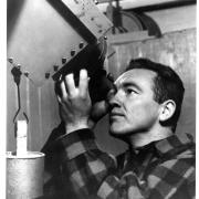 Walter Orr Roberts as a young man, seen looking through a telescope