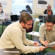 Research expert helping a student at a previous Write-In event.
