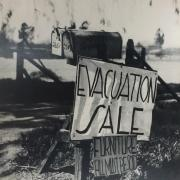 An image of an mailbox with a sign that says Evacuation Sale.