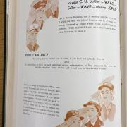 A photo of pages with text and illustrations of soldiers.