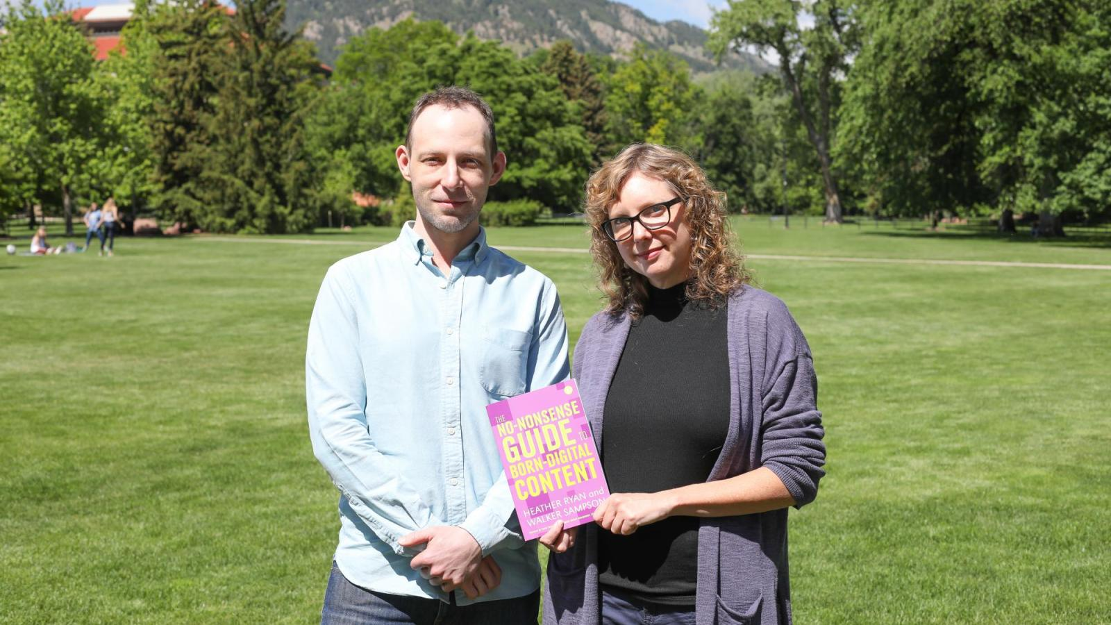 Professors Walker Sampson and Heather Bowden hold their book.