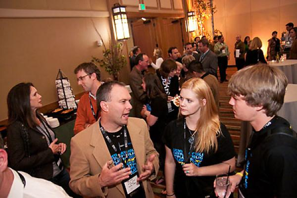 A group talks at a conference.