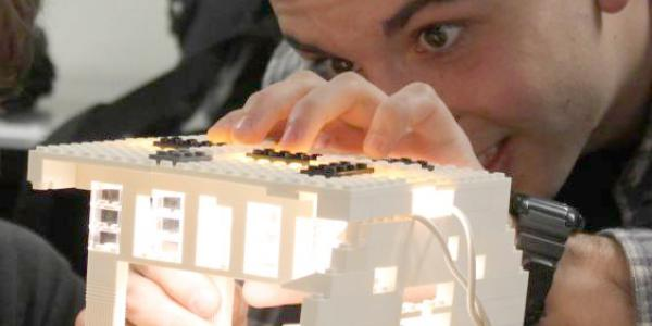 Student creates a lighting model with legos.