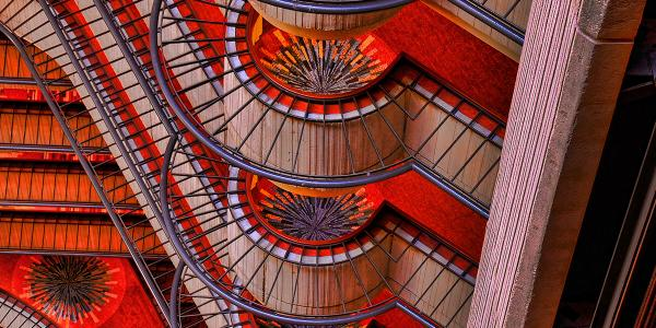 A multi-story building is shown inside in well-lit shades of red.