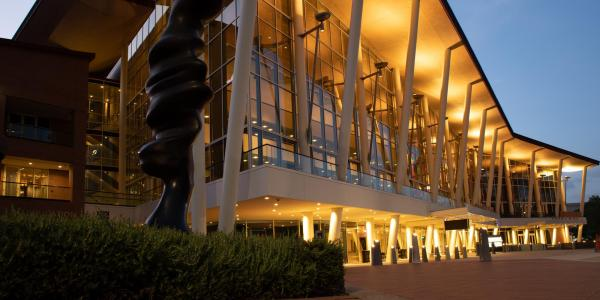 A well-lit building exterior at night