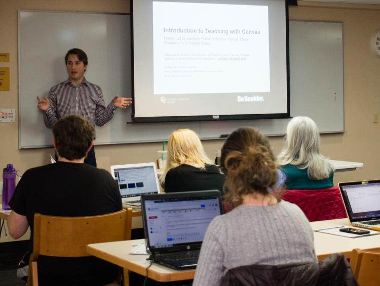 A trainer discusses Canvas in front of a roomful of attendees at a recent training.
