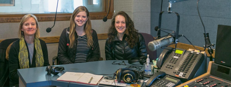 Madaline Pellicore and Emily Schaldach, Commuinity partner Jennifer Korbelik at KGNU