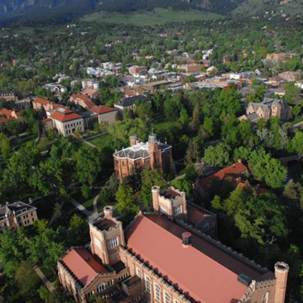 An aerial view of Macky Auditorium, Old Main and older end of the Boulder Campus with the Flatirons in background. (Photo by Casey A. Cass/University of Colorado)