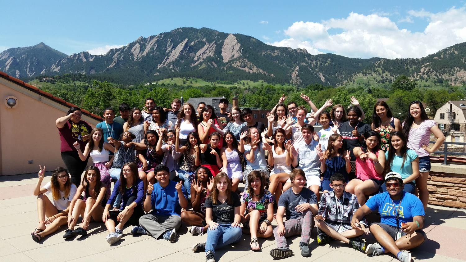 Students Pose Together with Mountains