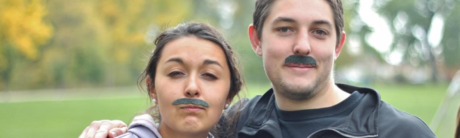 Students Being Goofy with Fake Mustaches