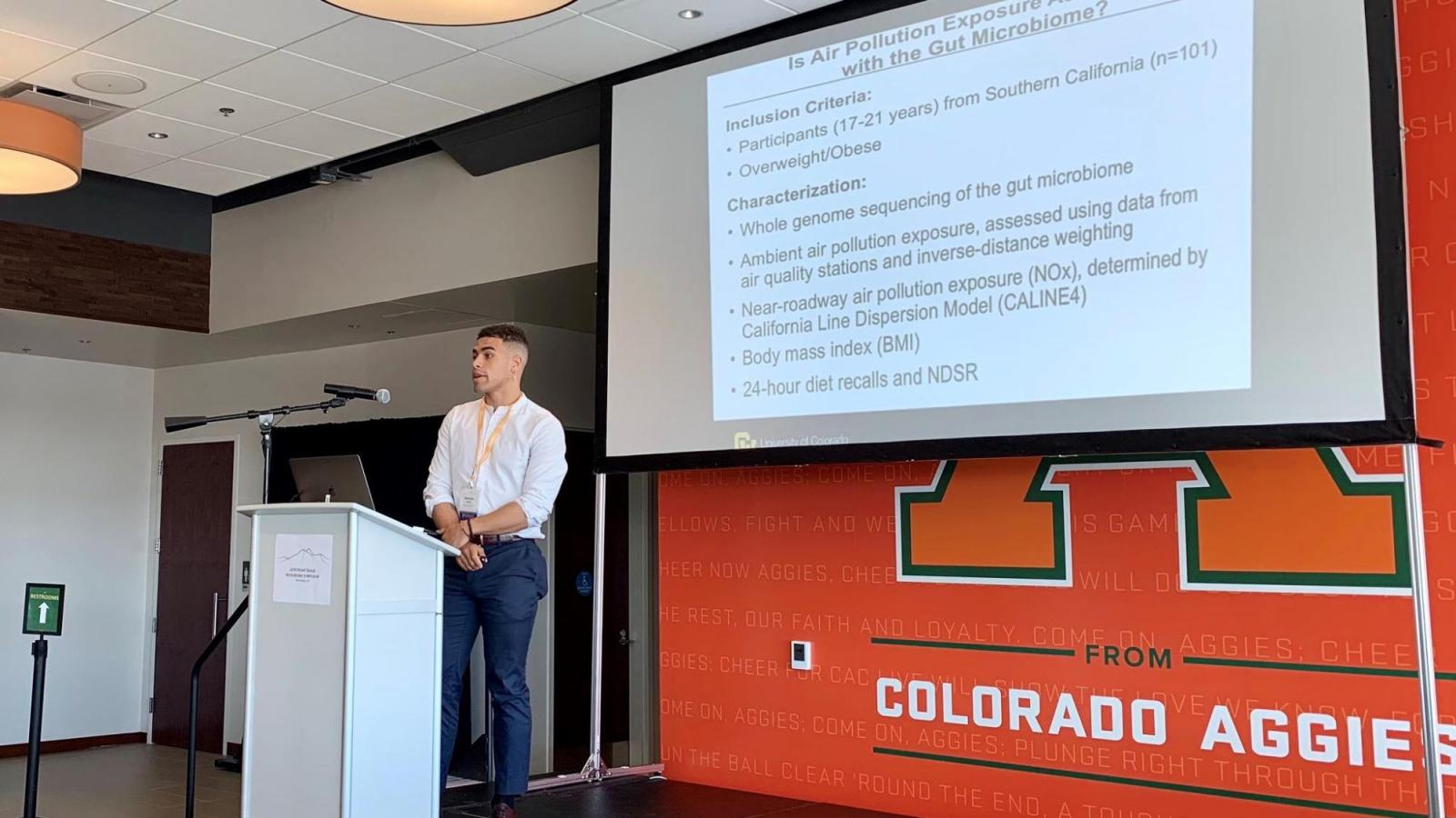 Max Bailey presents research at a podium