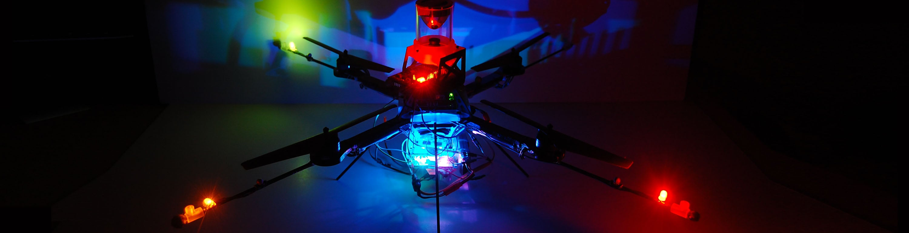 An unmanned aerial vehicle with colored lights.