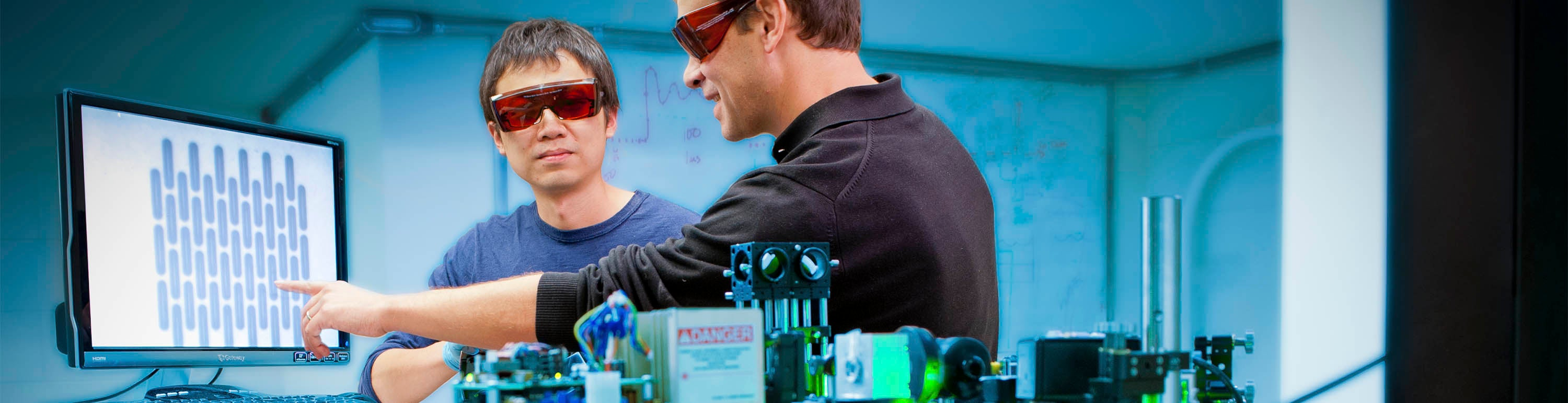 Student and professor doing visible laser research.