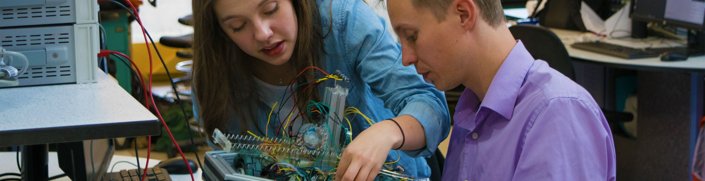 Two students working on a robot