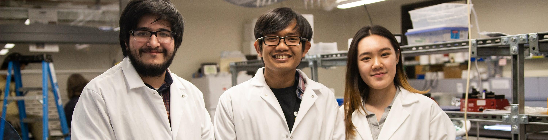 graduate student researchers in lab coats