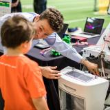 Teaching child at Engineering Projects Expo 2019