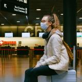 girl in airport wearing mask