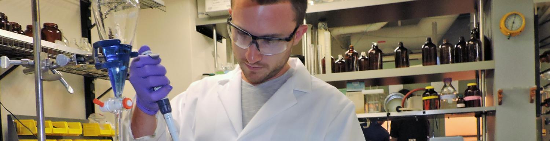 A graduate student conducting biomedical research.