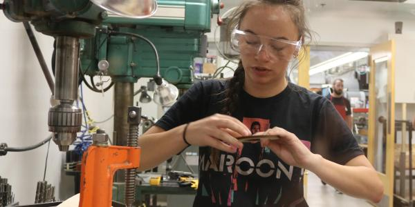 Alyvia Hildebrand works in the lab