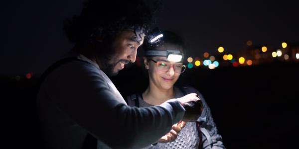 Kaushik and student in a field at night