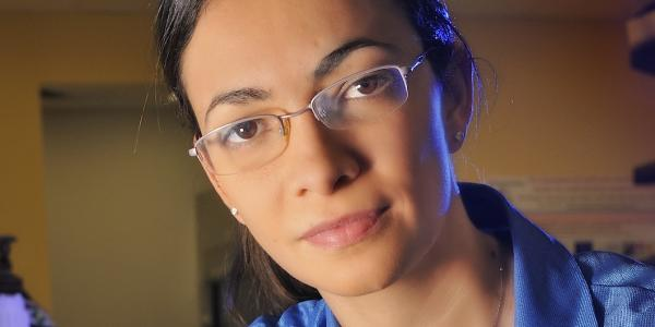 Marina Vance in a labcoat.
