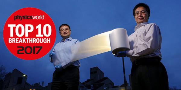Ronggui Yang and Xiaobo Yin holding the metamaterial.