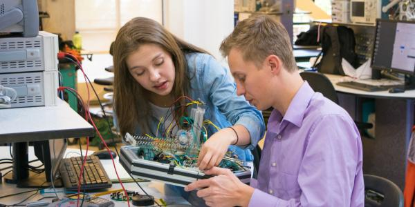 Two students working on a mechatronics robot.