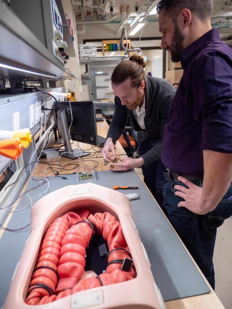 Micah Prendergast works on Endoculus robotic capsule endoscope
