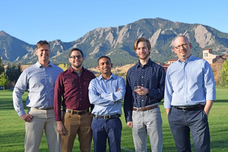 Victor Bright with his researchers in front of the Boulder Flatiron mountains.