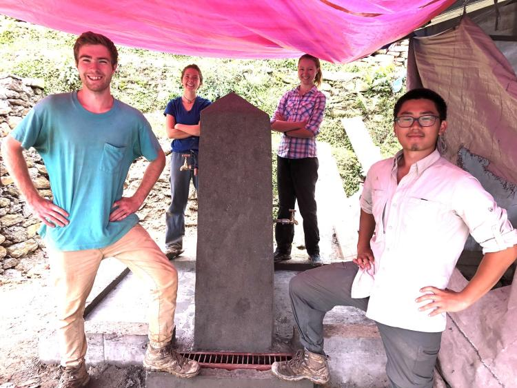 Emily and the CU EWB Nepal Team pose with the completed tapstand at the Balodaya Secondary School.