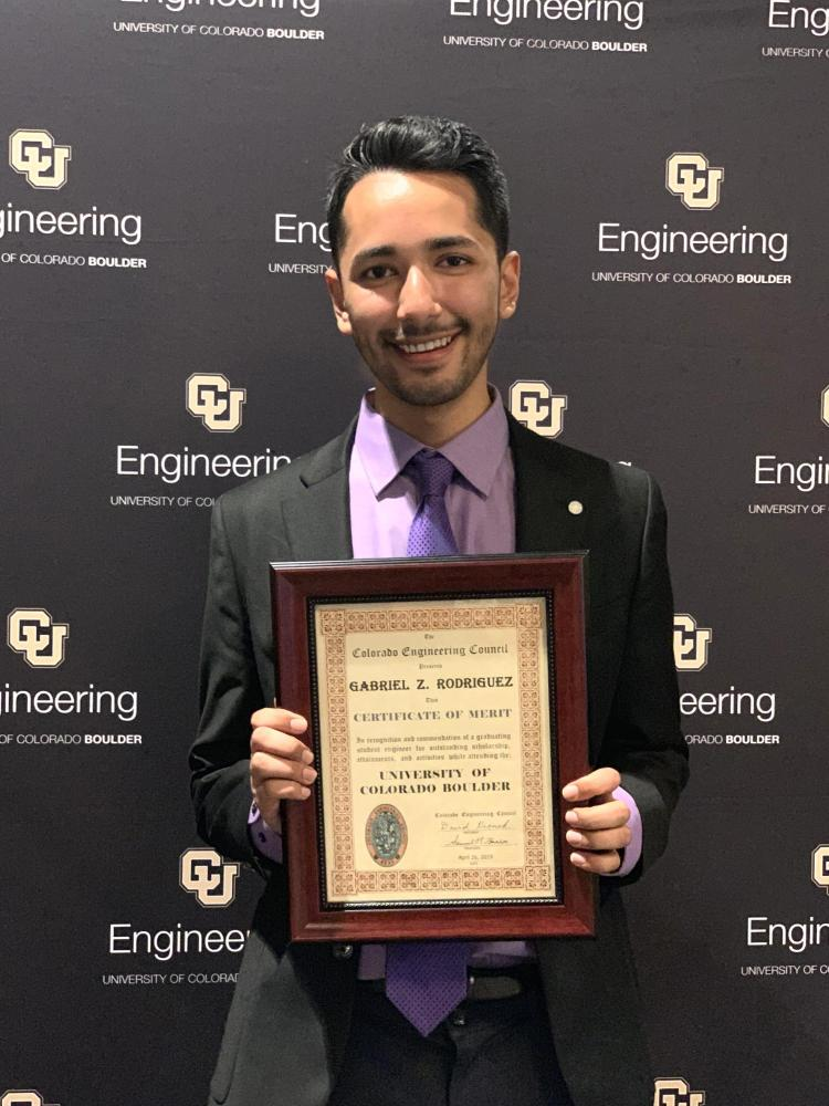 Gabe with award