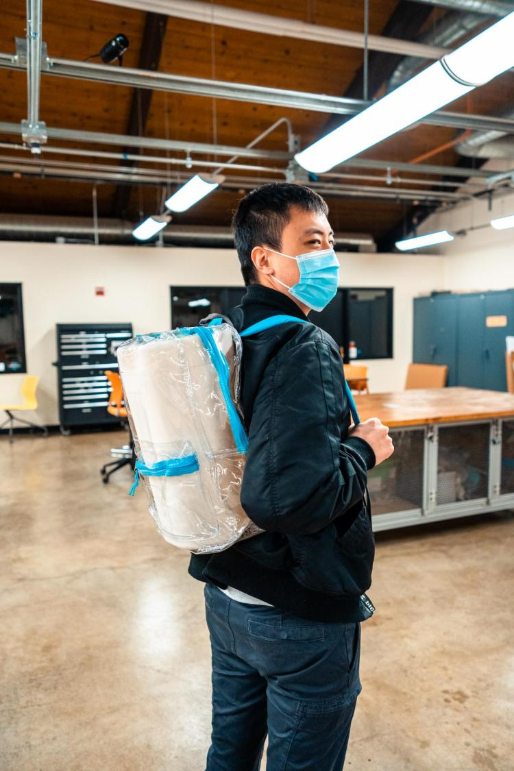 Gary Yu with device in backpack.