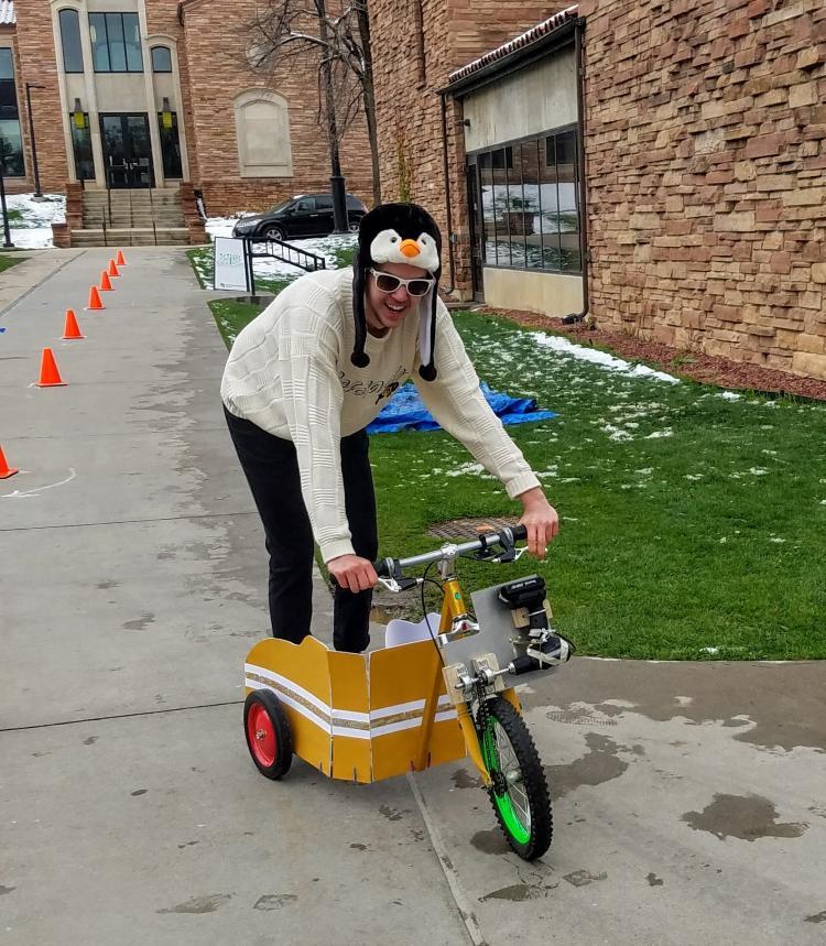 Jonathan riding a component design drill powered bike