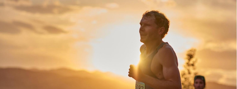 Image of Jake Riley running in sunshine