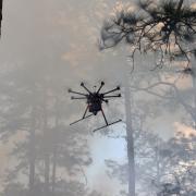 drone flies in smoke